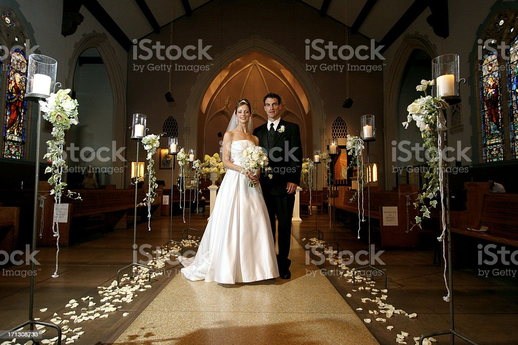 Wedding Portrait Bride and Groom Couple Inside Old Church Aisle stock photo