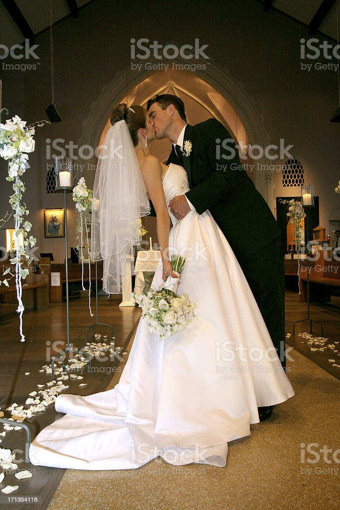 Wedding Portrait Bride and Groom Couple Kissing Inside Old Church stock photo