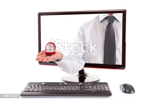 Male is holding ring in computer monitor.