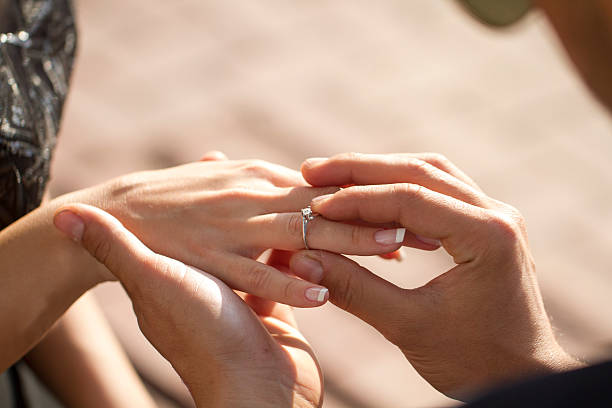 wedding propose with dimond ring - diamond ring hand stock photos and pictures