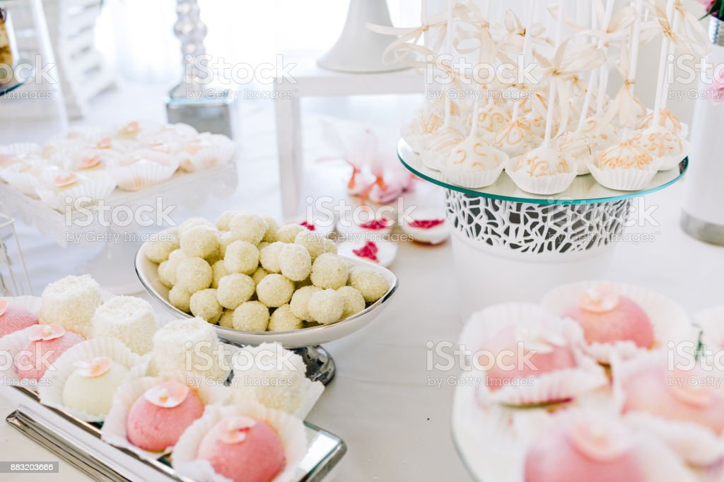 Wedding Reception Dessert Table With Delicious Decorated White