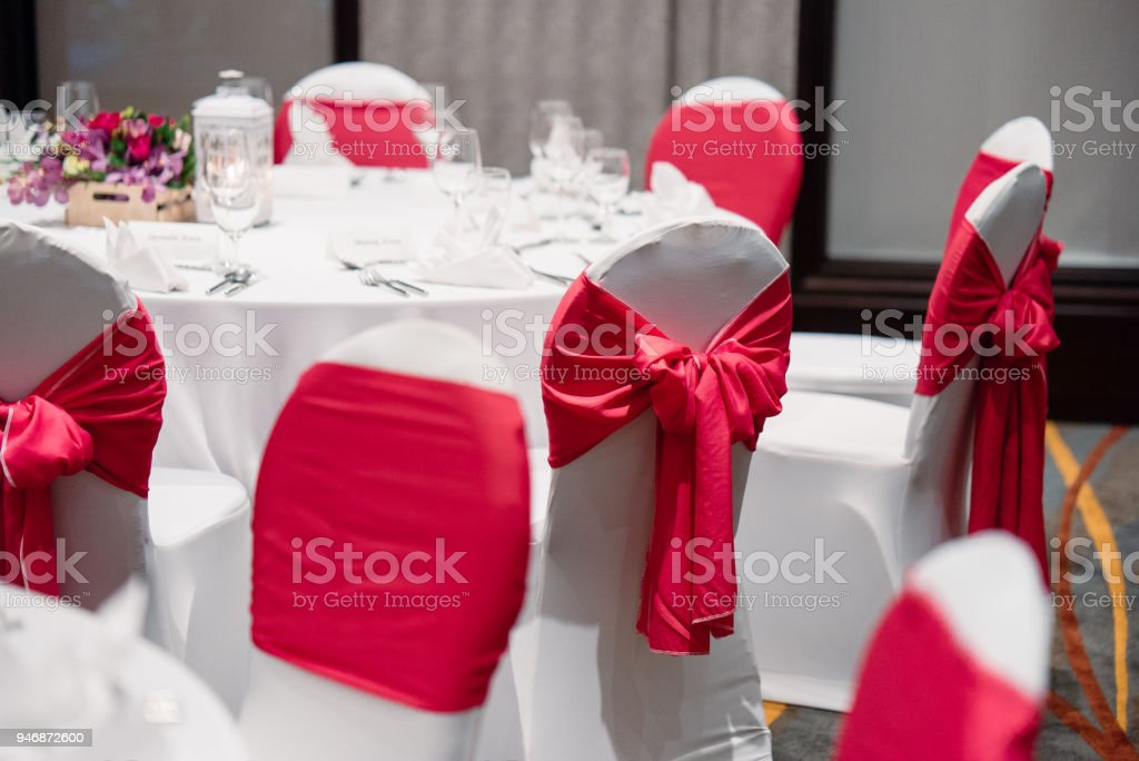 Wedding Reception Dinner Table Setup In White And Red Theme Stock