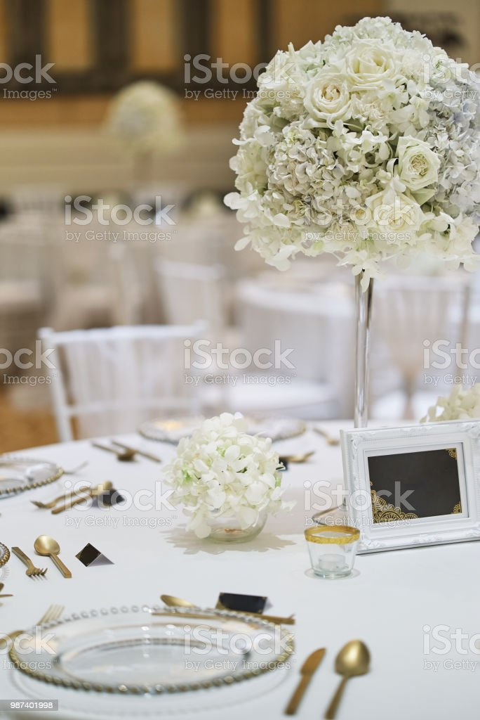 Wedding Reception Dinner Table Setup With Flower Bouquet Decoration ...