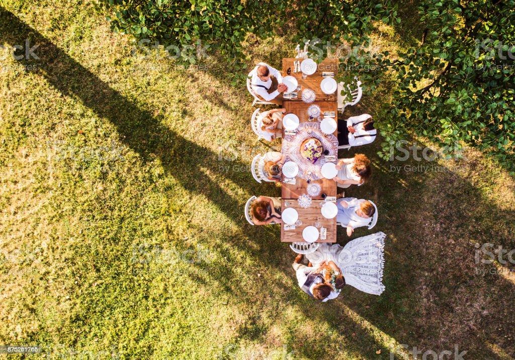 Wedding reception outside in the backyard. stock photo