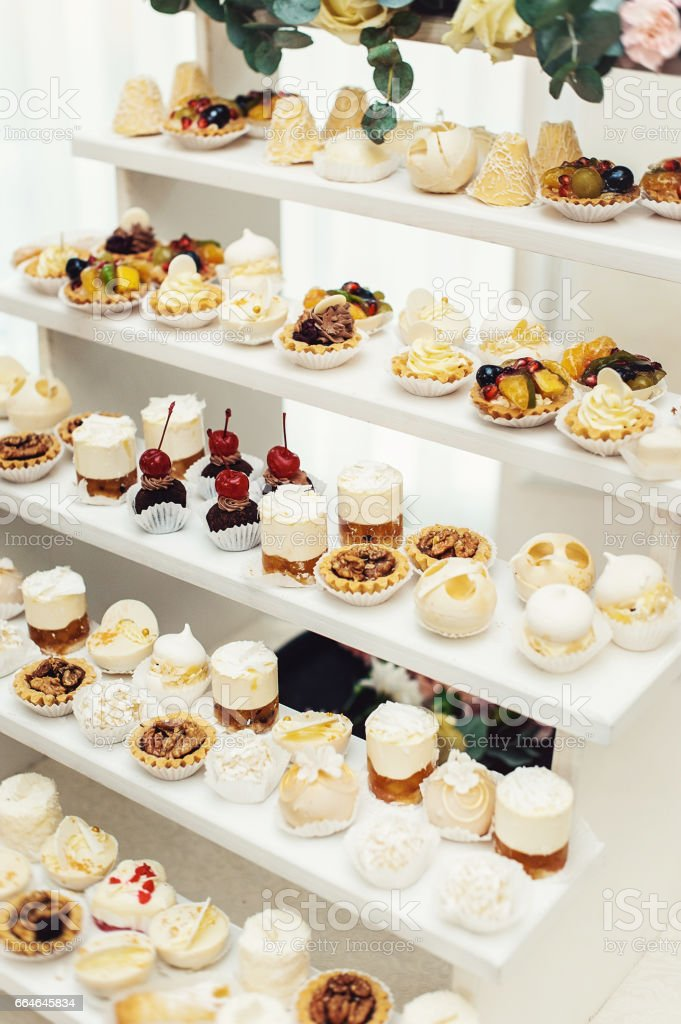 Wedding Reception Stand With Sweets Candies Dessert Cupcakes Muffins
