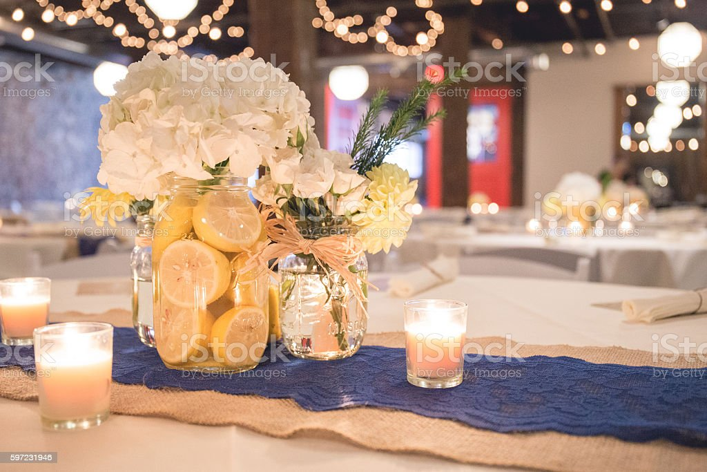Wedding Reception Table Centerpiece Of White And Yellow