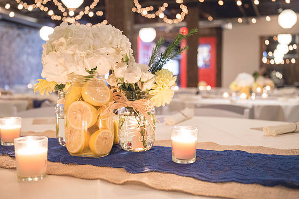Wedding Reception Table Centerpiece of White and Yellow Flowers stock photo