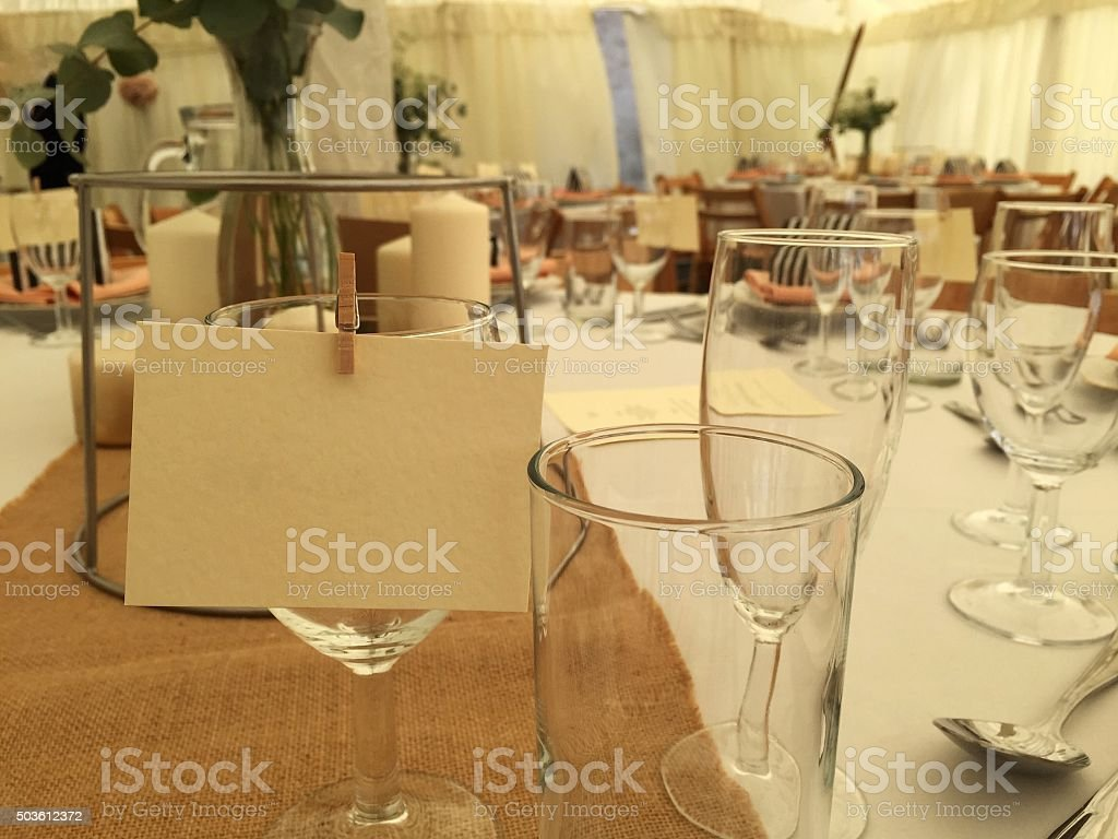 Wedding reception table with blank name tag stock photo