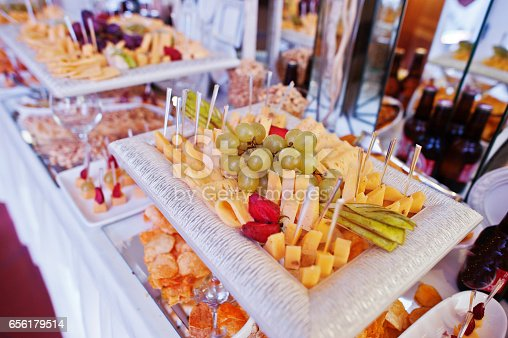 Wedding Reception Table With Different Cheese And Snacks For Beer