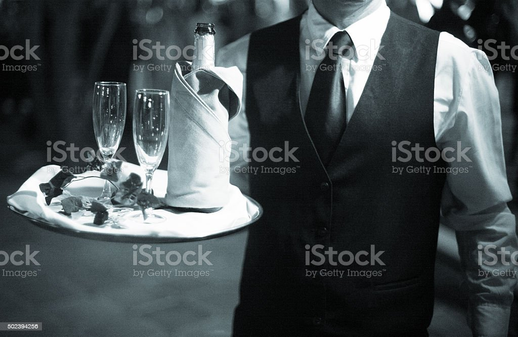Wedding reception waiter with champagne glasses stock photo