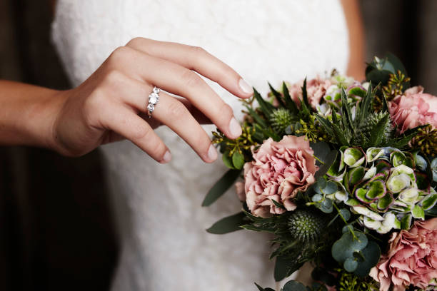 Wedding ring and blooms stock photo