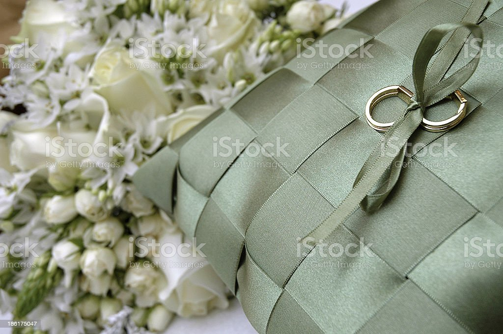 wedding ring and bouquet stock photo