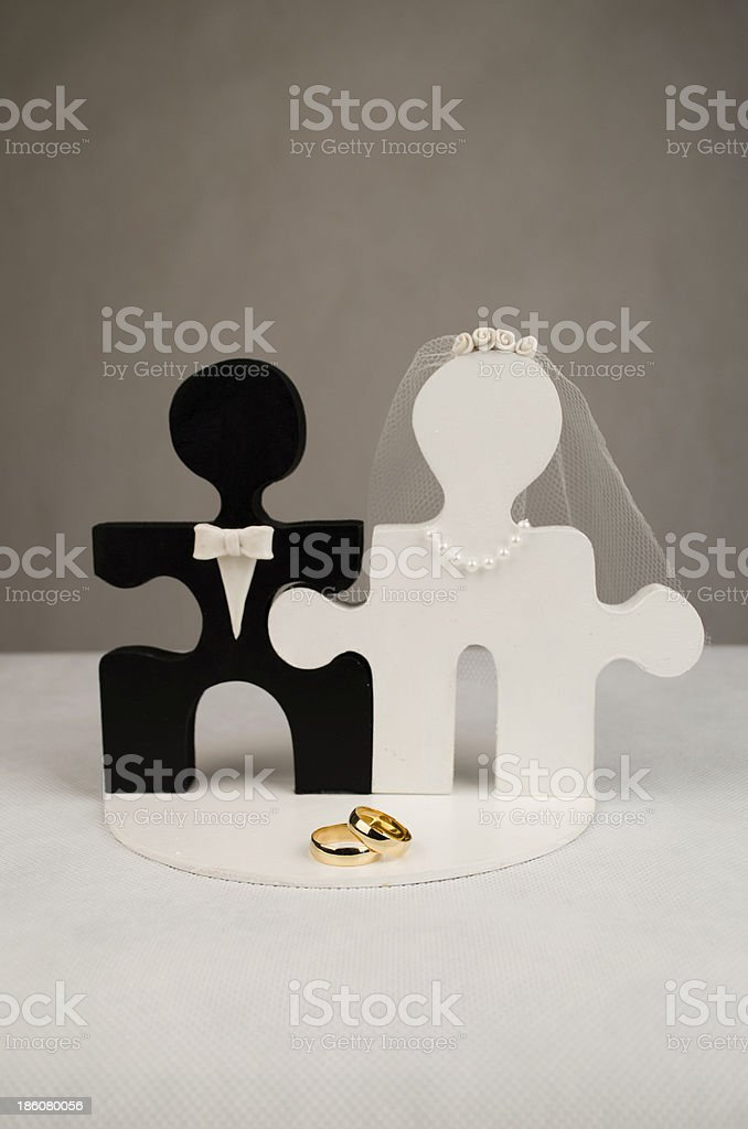 Wedding ring and grooms hands with puzzle stock photo