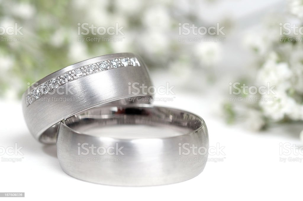 wedding ring and gypsophila in background royalty-free stock photo