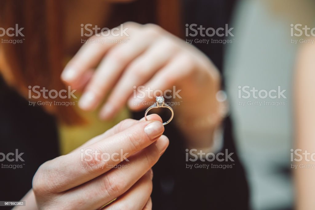 Wedding ring in hand of woman.  Close up. stock photo