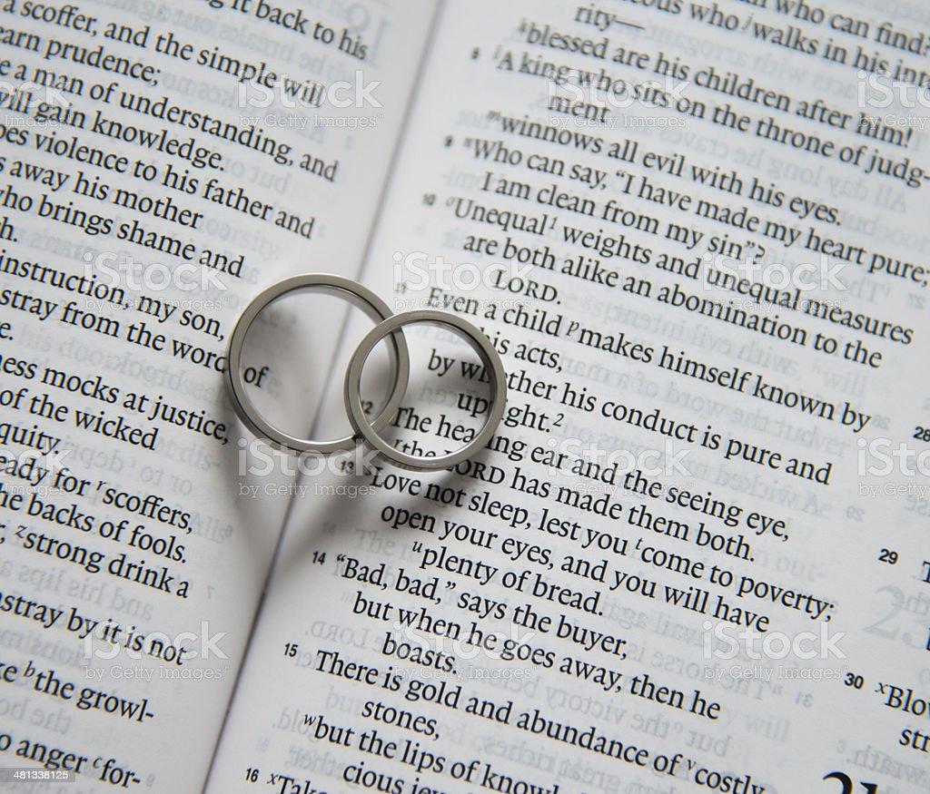 wedding ring on bible royalty-free stock photo