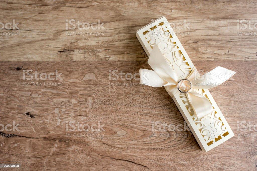 Wedding invitation box and invitation card on wooden background....
