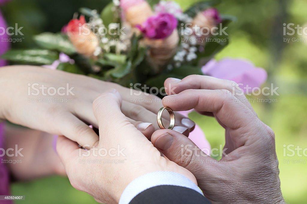 Wedding ring putting royalty-free stock photo