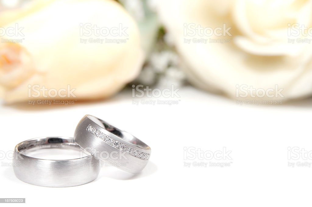 wedding ring with white roses stock photo