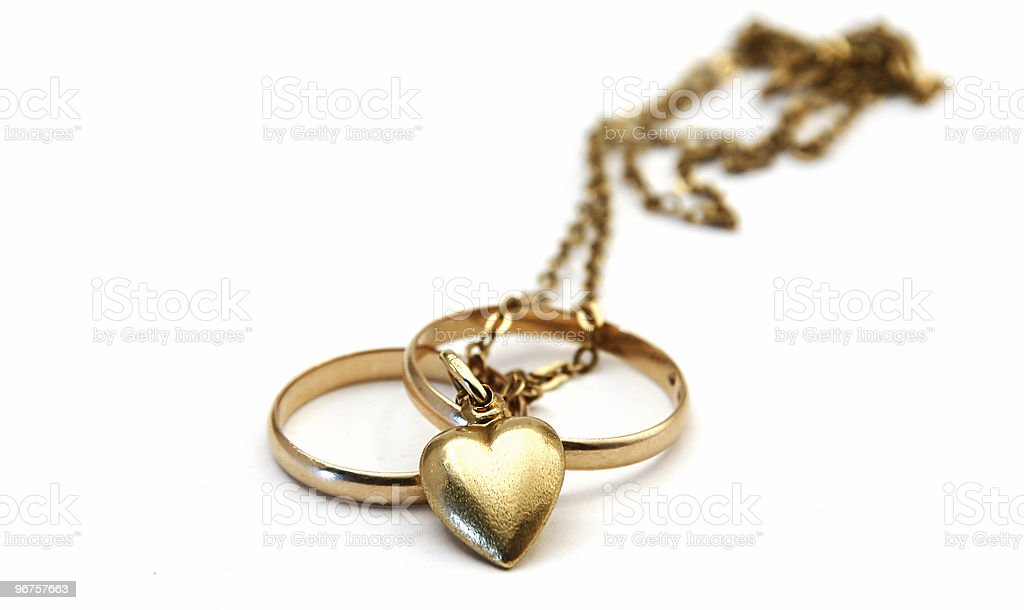 wedding rings and a golden heart royalty-free stock photo
