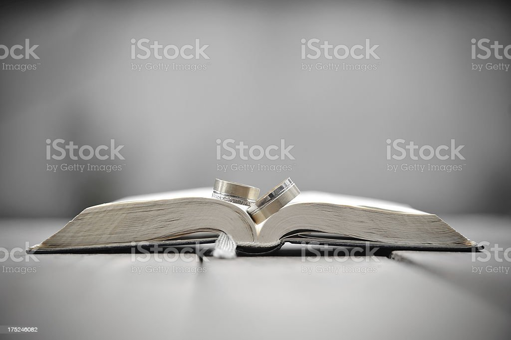Wedding rings and bible. stock photo