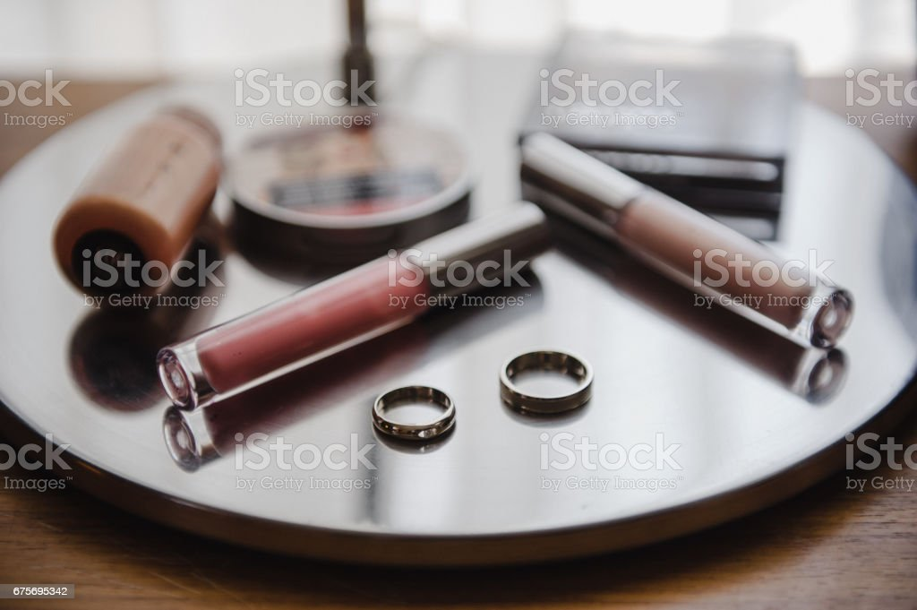 Wedding rings and cosmetics. Wedding details. royalty-free stock photo