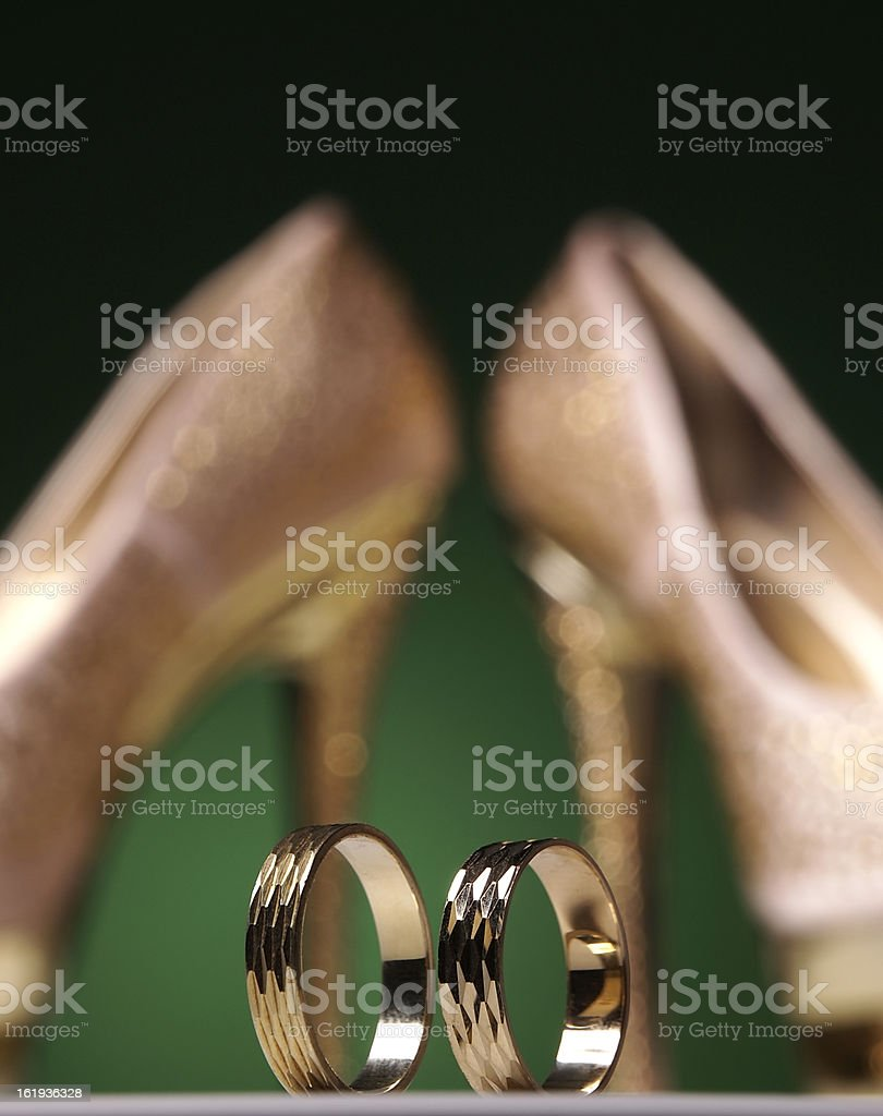 Wedding rings and high heels stock photo