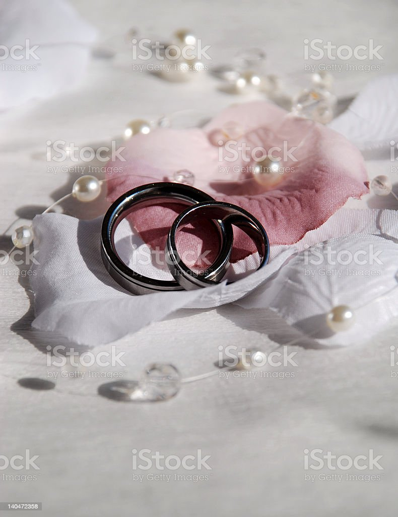 wedding rings and petals of rose royalty-free stock photo