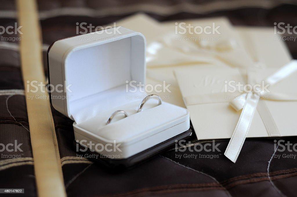 Wedding rings and wedding invitations stock photo