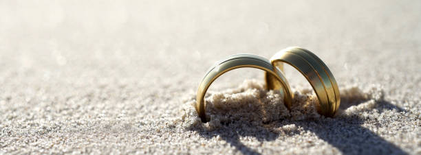 Wedding rings at the beach stock photo