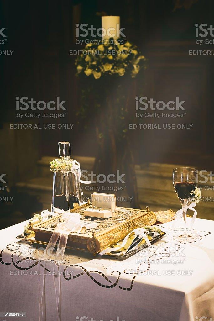 Wedding rings Bible wine chalice stock photo