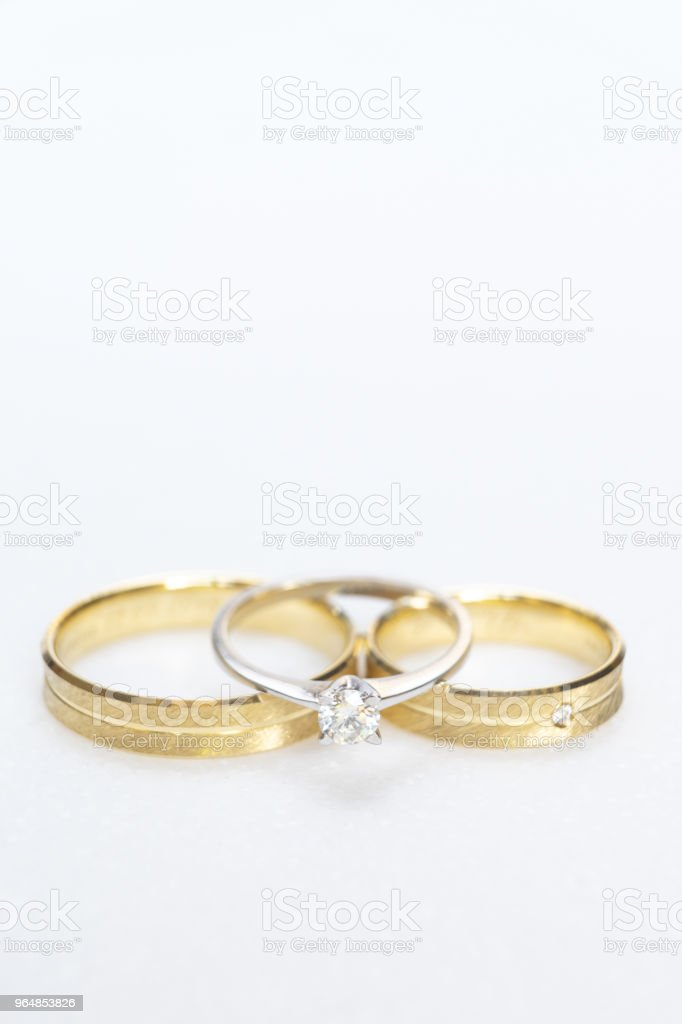Wedding rings, close up on white background. royalty-free stock photo