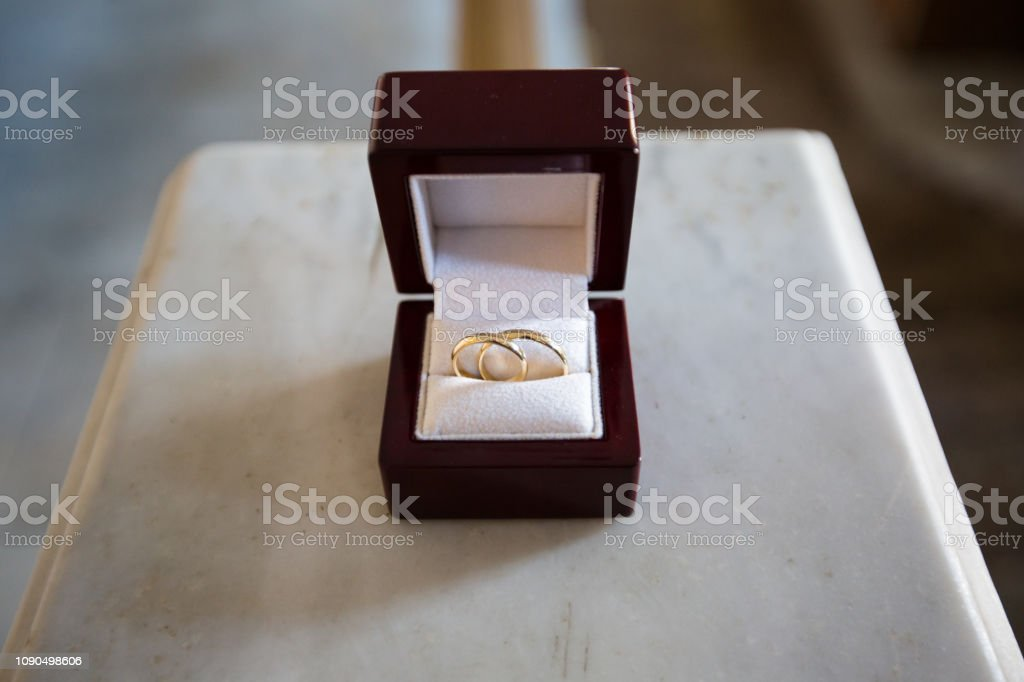 Wedding rings in a brown wooden jewelry box