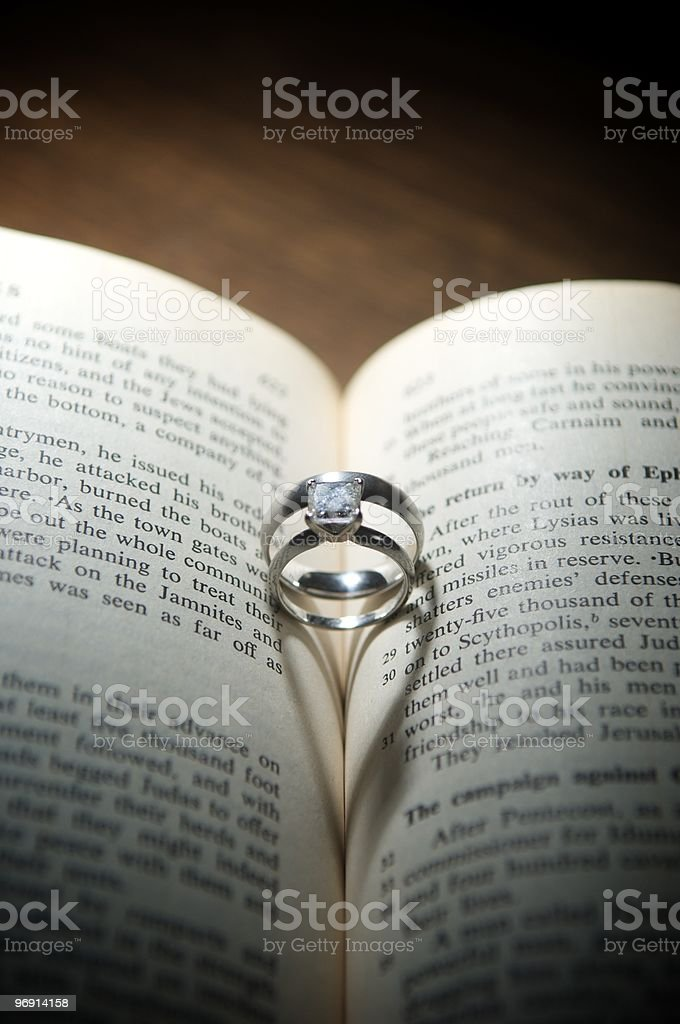 wedding rings in bible royalty-free stock photo