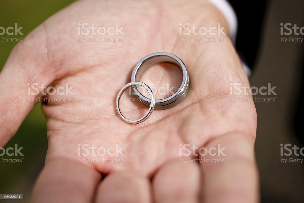 wedding rings in hand royalty-free stock photo