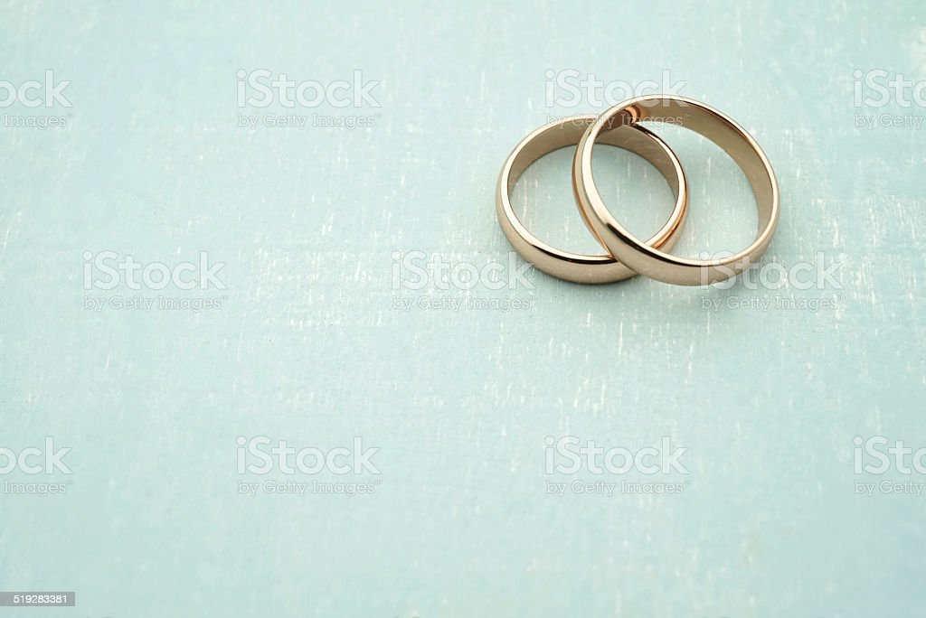 Wedding rings in rose gold with copy space stock photo