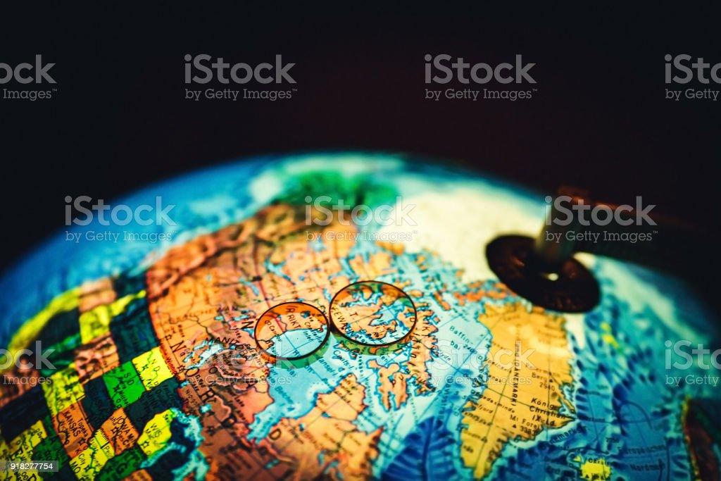 Wedding Rings Lie On The Luminous Globe Stock Photo Istock