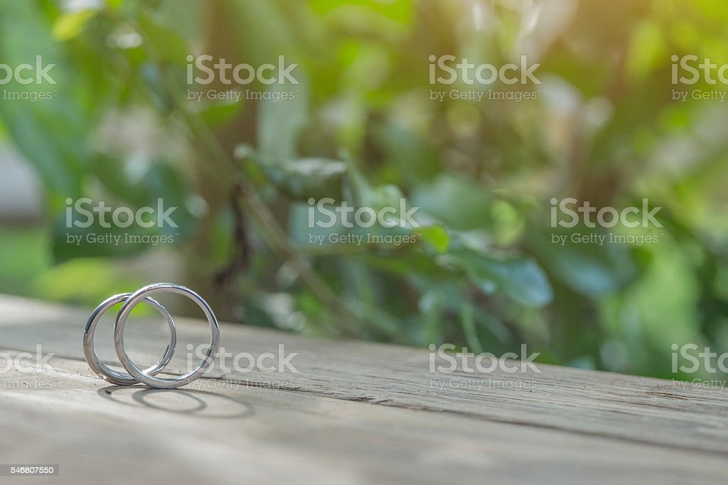 Wedding rings  on a wooden table. stock photo