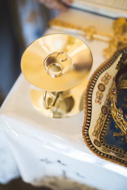 Wedding rings on ceremony at church. Macro stock photo