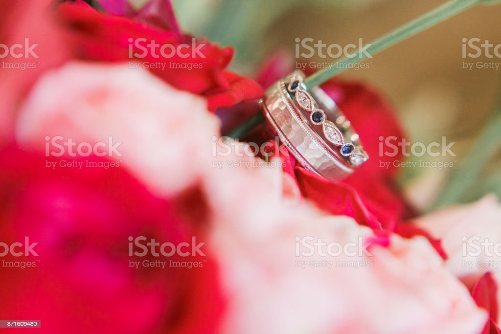 wedding rings on flowers bouquet. Close-up view stock photo