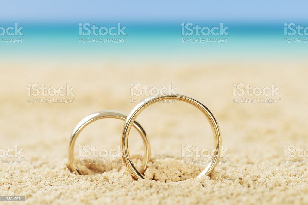 Wedding Rings On Sand stock photo