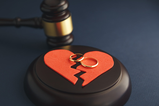 Wedding Rings On The Figure Of A Broken Heart From A Tree Hammer Of A Judge On A Wooden Background Divorce Stock Photo - Download Image Now