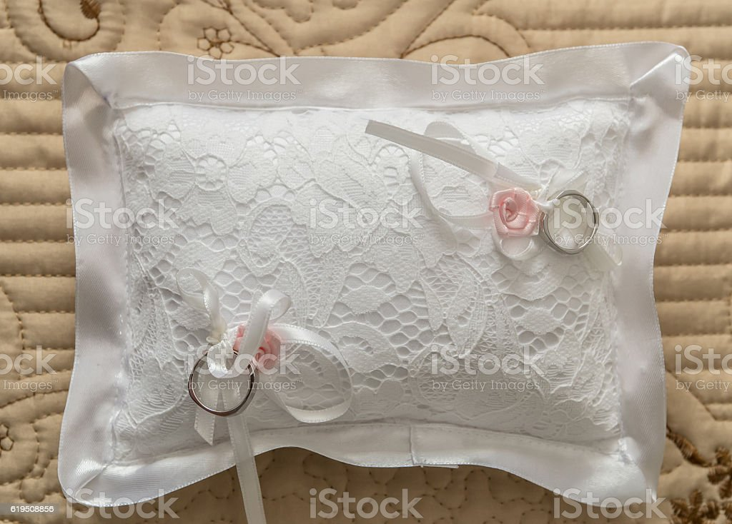 Wedding rings on the pillow stock photo