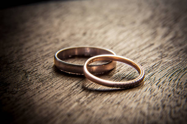 Wedding rings on wood stock photo