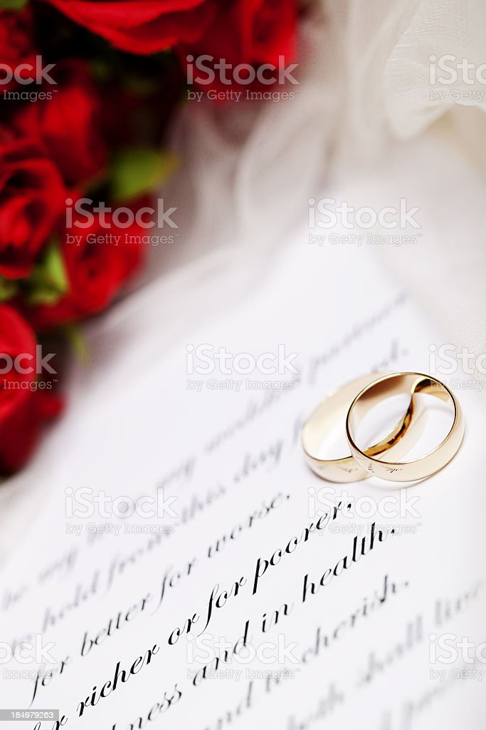 Wedding Rings, Vows And Red Rose Bouquet Royalty Free Stock Photo