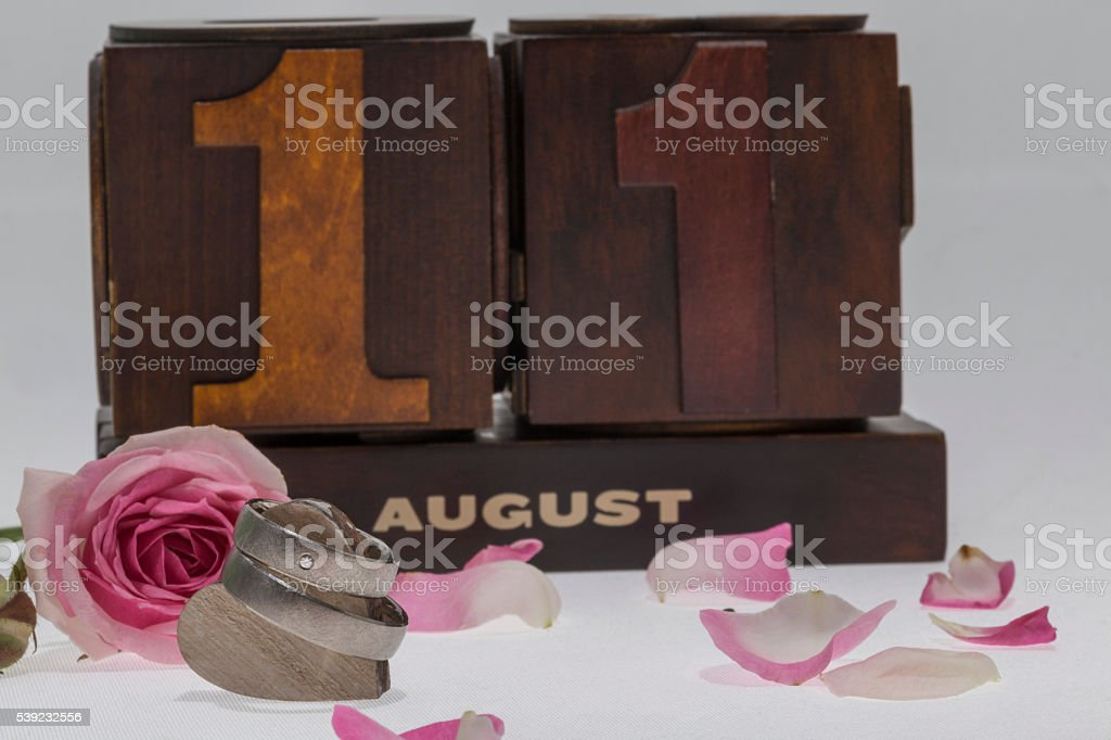wedding rings with a rose and the wedding date royalty-free stock photo