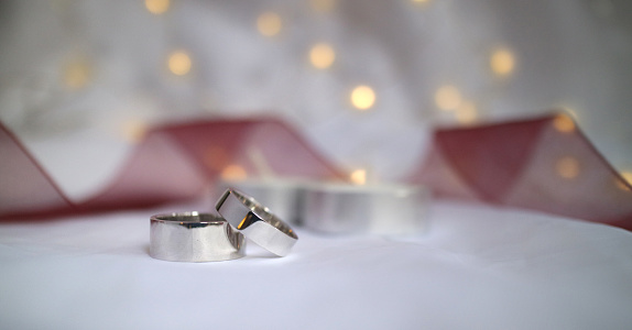 155315629 istock photo Wedding rings with candel , red ribbon and lamp 1259738599