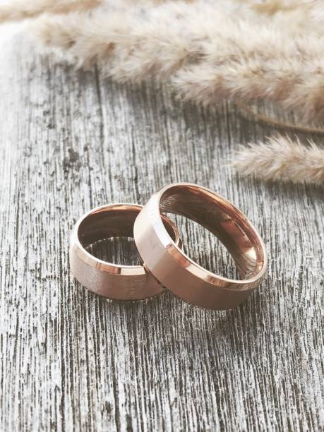 Wedding rings with dry wood and grain stock photo