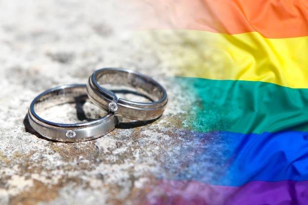 Wedding rings with rainbow flag stock photo
