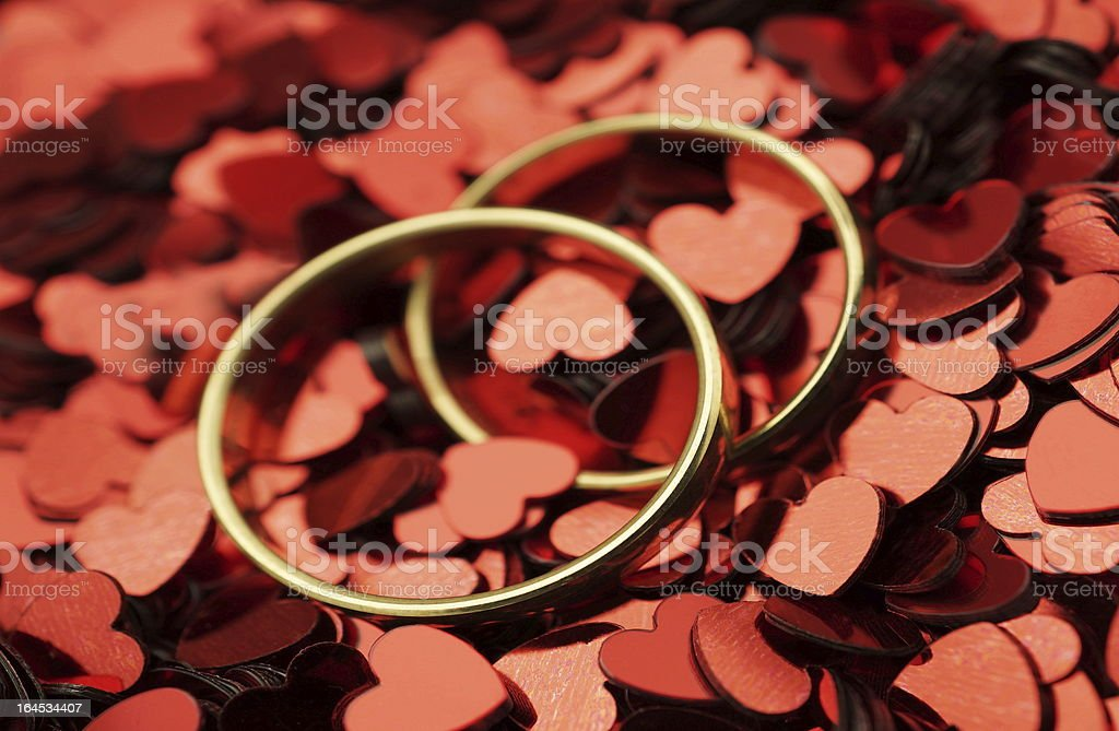 Wedding rings with red hearts royalty-free stock photo